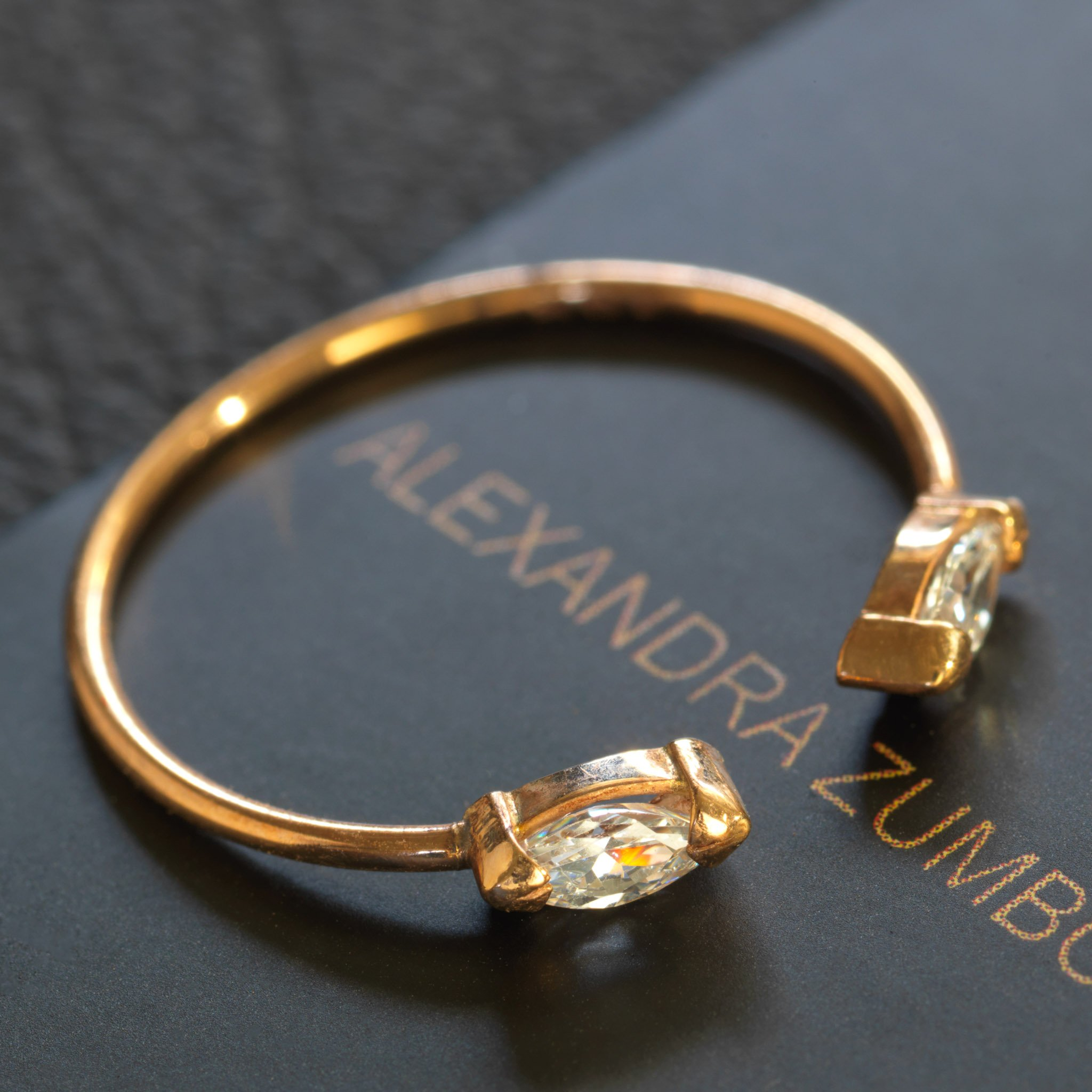 Gold ring with two jewels