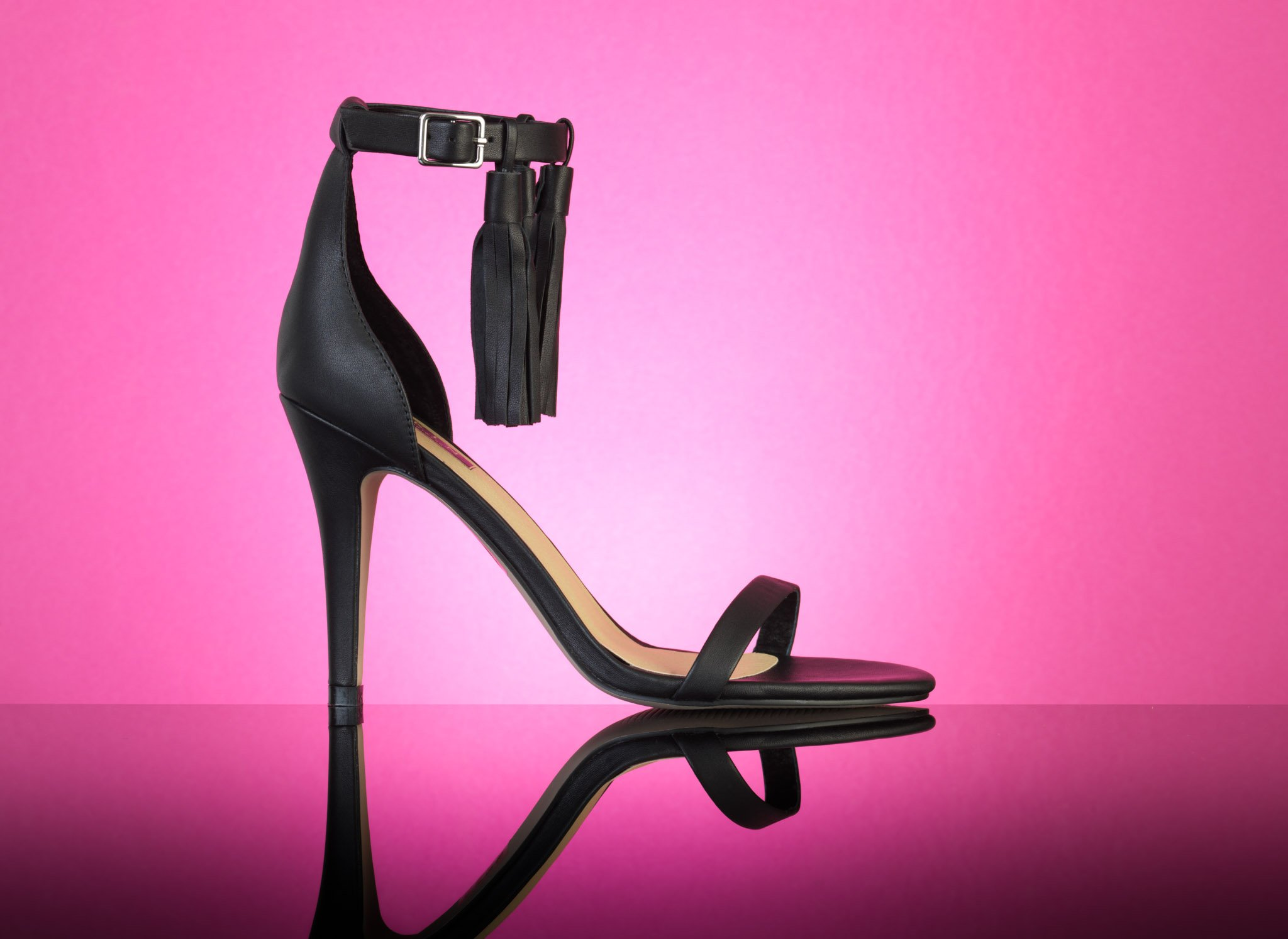 Shoe photography - High Heels on red background