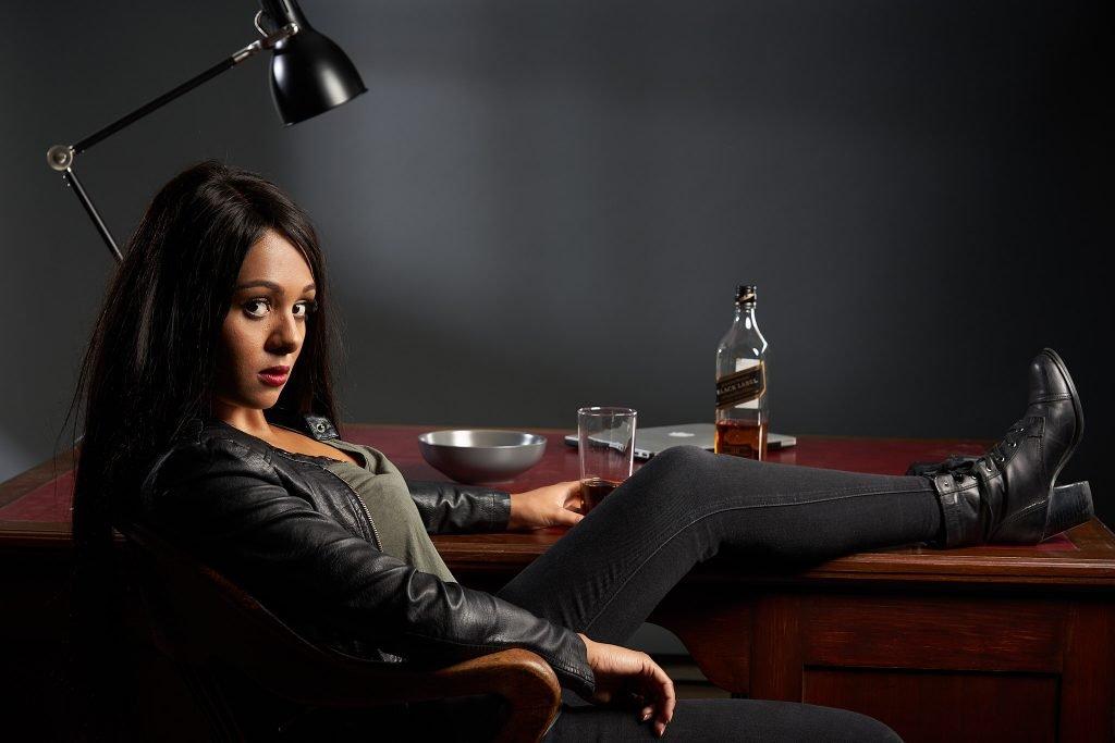 Jessica Jones in front of desk