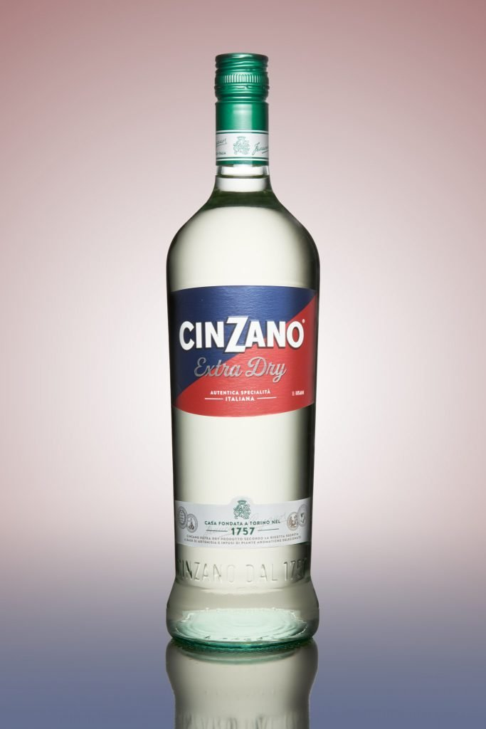 Cinzano bottle on coloured background