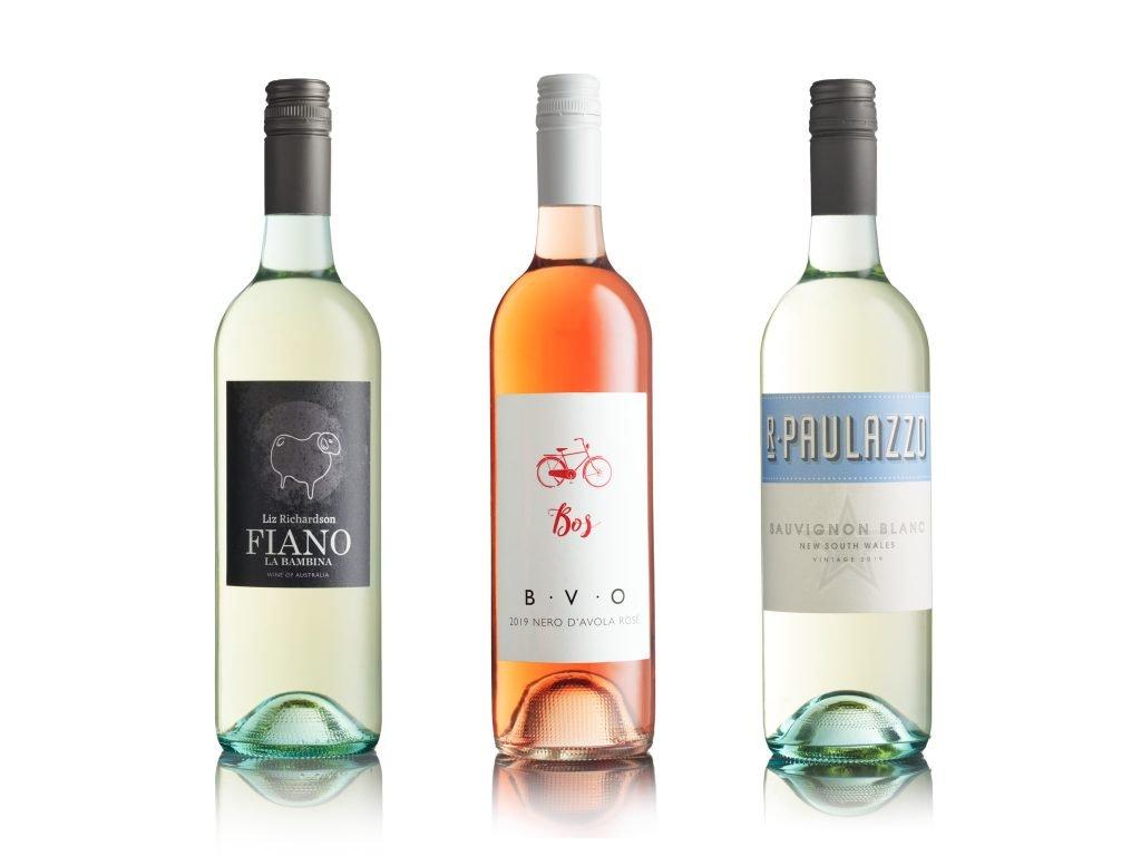 Wine bottle photography showing three bottles of white wine